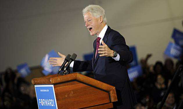 Former President Bill Clinton speaks to a packed crowd at Indian River High School in Chesapeake, Va. on Saturday, Nov. 3, 2012. (AP Photo/The Virginian-Pilot, Amanda Lucier) MAGS OUT