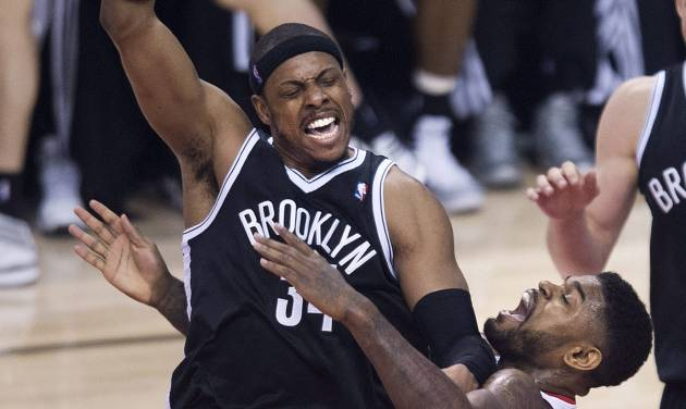 Toronto Raptors forward Amir Johnson, right, fouls Brooklyn Nets forward Paul Pierce, left, during the first half of Game 5 of the opening-round NBA basketball playoff series in Toronto, Wednesday, April 30, 2014. (AP Photo/The Canadian Press, Nathan Denette)