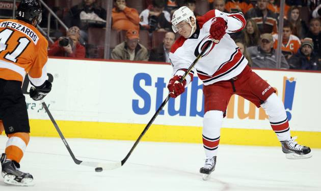 Carolina Hurricanes' Alexander Semin, right, launches a wrist shot past Philadelphia Flyers' Andrej Meszaros that went in for a goal during the first period of an NHL hockey game, Wednesday, Jan. 22, 2014, in Philadelphia.  (AP Photo/Tom Mihalek)