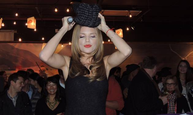 "In this Saturday, Jan. 19, 2013 photo, actress AnnaLynne McCord tries on a cat-shaped knit hat at the ""Catdance Film Festival,"" where cat-themed shorts were shown during the Sundance Film Festival in Park City, Utah. (AP Photo/Nekesa Mumbi Moody)"