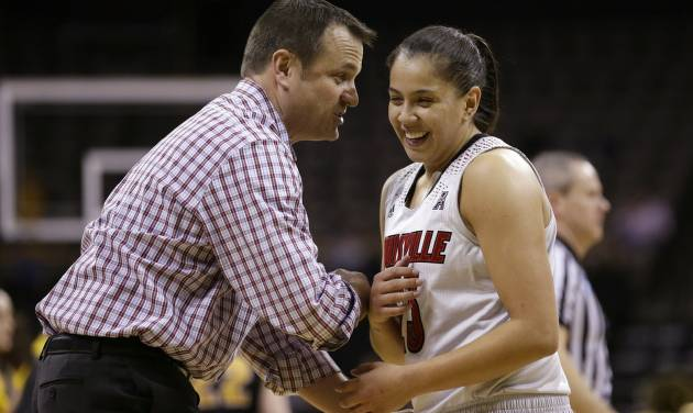 Louisville head coach Jeff Walz, left, laughs with guard Shoni Schimmel during the second half of an NCAA tournament second-round women's college basketball game against Iowa, Tuesday, March 25, 2014, in Iowa City, Iowa. (AP Photo/Charlie Neibergall)