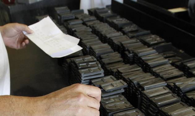 FILE- In this May 15, 2012 file photo, an inmate selects the letters and numbers to be used to make a memorial specialty license plate by Prison Industries at Folsom State Prison in Folsom, Calif.  The memorial plate is one of several  special-interest plates Californians can buy.  State auditors reported significant problems Thursday, April 18, 2013, in how California agencies collect and spend money from certain specialty license plate funds. Gov. Jerry Brown and his predecessor, Arnold Schwarzenegger diverted $3 million of the $15 million raised for the California Memorial Scholarship Program to help close the state's budget deficit and never paid the money back.(AP Photo/Rich Pedroncelli, File)
