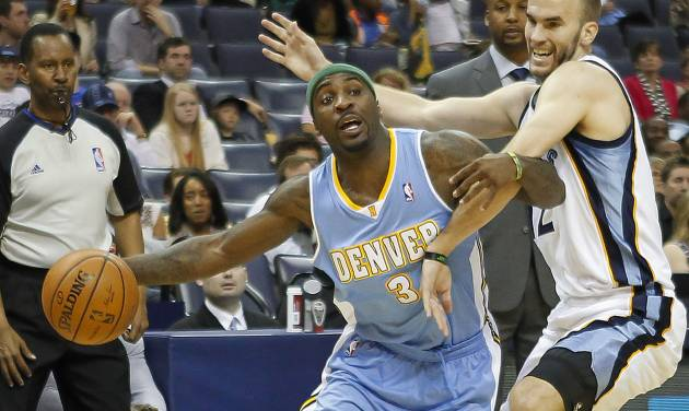 Denver Nuggets guard Ty Lawson (3) tries to get around Memphis Grizzlies guard Nick Calathes in the first half of an NBA basketball game Friday, April 4, 2014, in Memphis, Tenn. (AP Photo/Lance Murphey)
