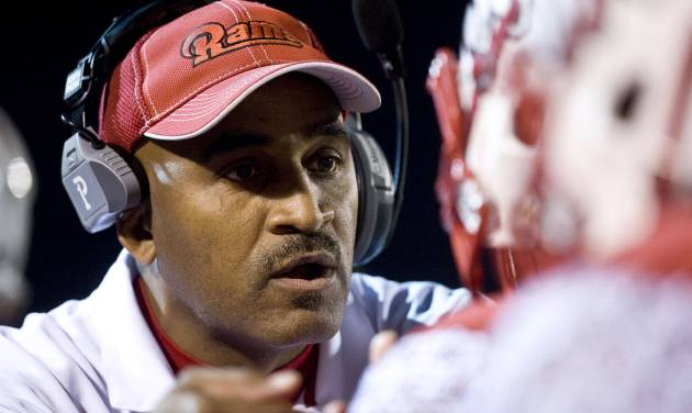 Winston-Salem State head coach Connell Maynor speaks with one of his players during an NCAA college football game on Saturday, Dec. 8, 2012 at Bowman-Gray Stadium in Winston-Salem, N.C. (AP Photo/Winston-Salem Journal, Andrew Dye)