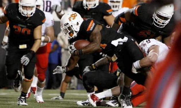 Oklahoma State's Jeremy Smith (31) scores a touchdown during a college football game between the Oklahoma State University Cowboys (OSU) and the University of Arizona Wildcats at Boone Pickens Stadium in Stillwater, Okla., Thursday, Sept. 8, 2011. Photo by Bryan Terry, The Oklahoman.