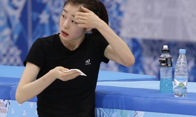 Yuna Kim of South Korea wipes her face during a practice session at the Iceberg Skating Palace during the 2014 Winter Olympics, Sunday, Feb. 16, 2014, in Sochi, Russia. (AP Photo/Darron Cummings)