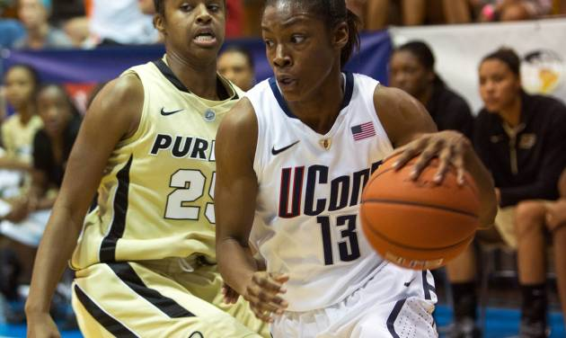 Connecticut guard Brianna Banks, right, dribbles past Purdue guard April Wilson during an NCAA women's college basketball game in St. Thomas, U.S. Virgin Islands, Saturday, Nov. 24, 2012. Connecticut won 91-57. (AP Photo/Thomas Layer)