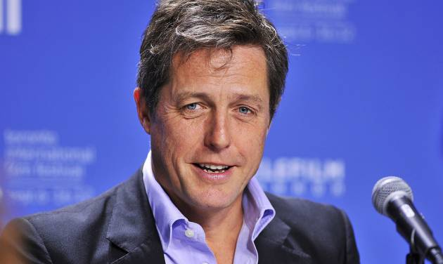 """FILE - In this Sept. 9, 2012 file photo, actor Hugh Grant speaks during the news conference for the film """"Cloud Atlas"""" during the 2012 Toronto International Film Festival in Toronto. Lord Justice Brian Leveson will release his report, Thursday, Nov. 29 2012, on a year-long inquiry into the culture and practices of the British press and his recommendations for future regulation to prevent phone hacking, data theft, bribery and other abuses. (AP Photo/The Canadian Press, Aaron Vincent Elkaim, File)"""