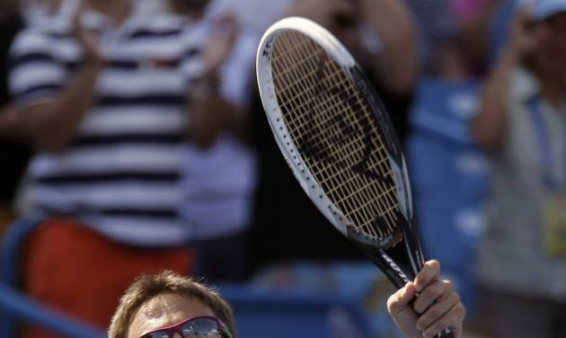 Tommy Robredo, from Spain, celebrates after upsetting Novak Djokovic, from Serbia, 7-6 (6), 7-5, during a match at the Western & Southern Open tennis tournament, Thursday, Aug. 14, 2014, in Mason, Ohio. (AP Photo/Al Behrman)