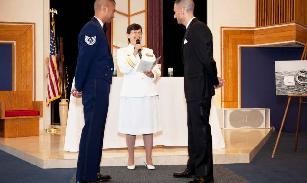 "ADVANCE FOR USE THURSDAY, JULY 5, 2012 AND THEREAFTER - In this Saturday, June 23, 2012 photo provided by Jeff Sheng, Navy Chaplain Kay Reeb of the Evangelical Lutheran Church of America officiates the civil union ceremony of Air Force Tech. Sgt. Erwynn Umali, right, and his partner Will Behrens at Joint Base McGuire-Dix-Lakehurst, the military base in Wrightstown, N.J. where Umali is stationed. Prior to repeal of the the ""don't ask, don't tell"" policy nine months ago, various conservative groups and individuals - including many conservative retired chaplains - warned that repeal would trigger an exodus of chaplains whose faiths consider homosexual activity to be sinful. In fact, there's been no significant exodus Moreover, chaplains or their civilian coordinators from a range of conservative faiths told The Associated Press they knew of virtually no serious problems thus far of repeal-related infringement of chaplains' religious freedom and rights of conscience. (AP Photo/Jeff Sheng)"