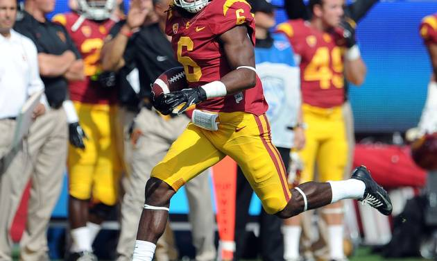 """FILE - In this Oct. 26, 2013, file photo, Southern California safety Josh Shaw recovers a Utah fumble in an NCAA college football game in Los Angeles. Shaw confessed that he lied to school officials about how he sprained his ankles last weekend, retracting his story about jumping off a balcony to save his drowning nephew. The school swiftly suspended him from all football team activities Wednesday, Aug. 27, 2014, and acknowledged his heroic tale was """"a complete fabrication."""" (AP Photo/Pasadena Star-News, Keith Birmingham, File) NO SALES"""