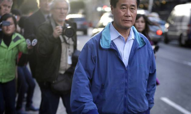 FILE - In this March 26, 2014 file photo, California state Sen. Leland Yee, D-San Francisco, right, leaves the San Francisco Federal Building in San Francisco. Yee, charged in a sweeping organized crime and public corruption case centered in San Francisco's Chinatown now also faces a racketeering charge. A federal grand jury on Friday, July 25, 2013 filed the additional charge against Yee. The grand jury says Yee took bribes in exchange for votes in favor of several legislative bills, including one on medical marijuana. (AP Photo/Ben Margot, File)