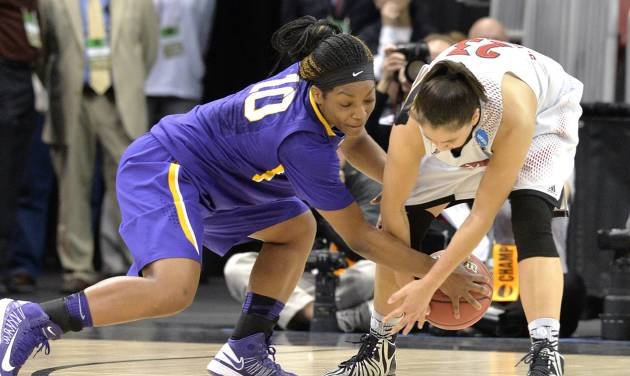 LSU's Jasmine Rhodes, left, battles Louisville's Shoni Schimmel for a loose ball during the first half in a regional semifinal game at the NCAA women's college basketball tournament on Sunday, March 30, 2014, in Louisville, Ky. (AP Photo/Timothy D. Easley)