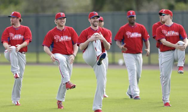 Philadelphia Phillies starting pitcher Cliff Lee, center, stretches with teammates during spring training baseball practice Thursday, Feb. 13, 2014, in Clearwater, Fla. (AP Photo/Charlie Neibergall)
