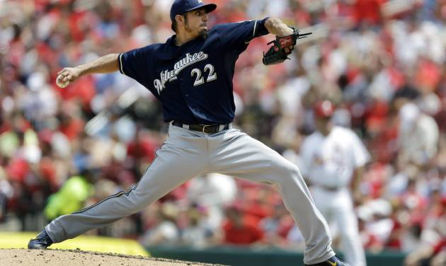 Milwaukee Brewers starting pitcher Matt Garza throws during the fourth inning of a baseball game against the St. Louis Cardinals, Sunday, Aug. 3, 2014, in St. Louis. (AP Photo/Jeff Roberson)
