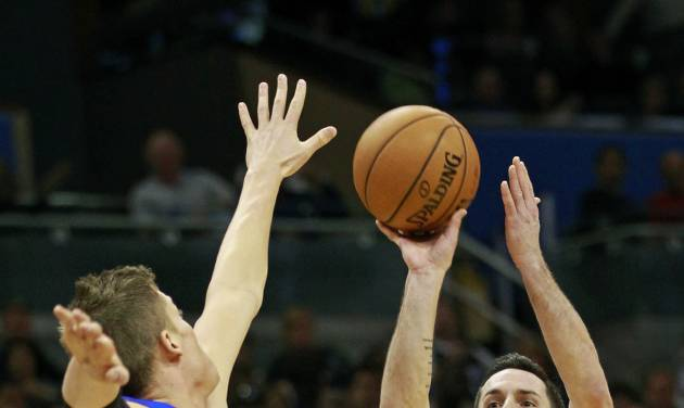 FILE - In this Nov. 21, 2012 file photo, Orlando Magic's J.J. Redick (7) takes a 3-point shot over the arms of Detroit Pistons' Jonas Jerebko, of Sweden, during the second half of an NBA basketball game in Orlando, Fla. A person familiar with the situation says the Orlando Magic have agreed to trade veteran shooting guard Redick, center Gustavo Ayon and reserve point guard Ish Smith to the Milwaukee Bucks in exchange for guards Doron Lamb and Beno Udrih, as well as forward Tobias Harris. The person spoke to The Associated Press Thursday, Feb. 21, 2013 on condition of anonymity because the deal was not officially complete. (AP Photo/John Raoux, File)