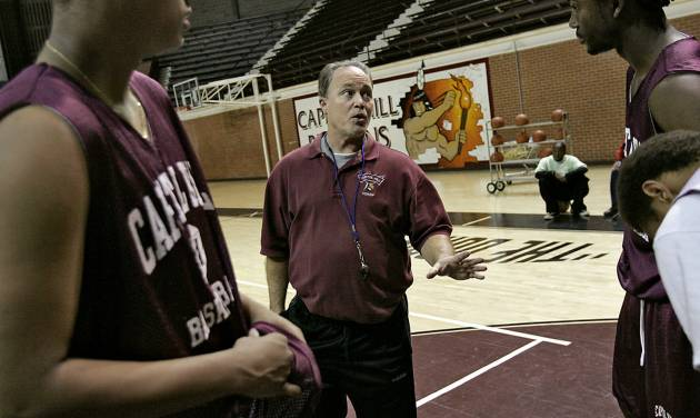 Capitol Hill High School's head basketball coach Donny Tuley coaches his players at The Dome at Capitol Hill High School in Oklahoma City, Okla., Tuesday, Jan. 22, 2007. By John Clanton, The Oklahoman ORG XMIT: KOD