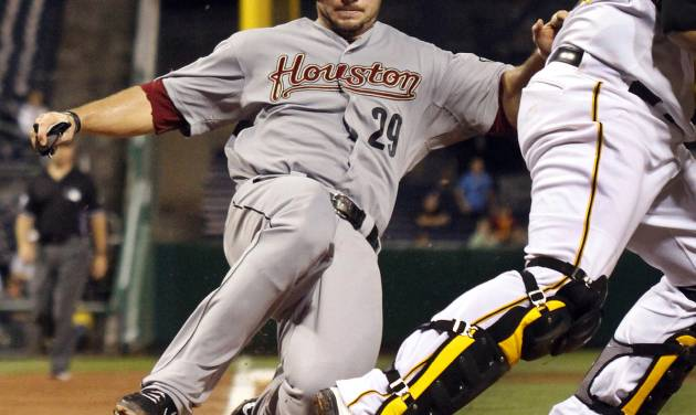 Houston Astros' Brett Wallace (29) is forced out at home as Pittsburgh Pirates catcher Rod Barajas, right, throws to first to complete a double play on Astros' Carlos Corporan during the fourth inning of a baseball game in Pittsburgh, Wednesday, Sept. 5, 2012. The Pirates won 6-3. (AP Photo/Gene J. Puskar)