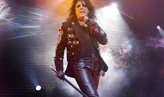 "FILE - This is a Sunday, Oct. 31, 2010 file photo of U.S musician Alice Cooper as he performs his 'Halloween Night of Fear' show at The Roundhouse in north London. Shock rocker Alice Cooper gave the audience at Tuesday night's Aug. 14, 2012 ""Rock of Ages"" show a surprise, by joining the cast of the London West End musical on stage. The 64-year-old delighted spectators by performing his classic hit ""School's Out"" - to mark the anniversary of the track going to No. 1 in the U.K. charts 40 years ago this week. (AP Photo/Joel Ryan, File)"
