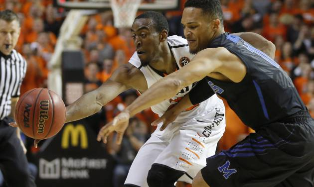 Oklahoma State's Markel Brown (22) reaches for the ball beside Memphis' Michael Dixon Jr. (11) during an NCAA college basketball game between Oklahoma State and Memphis at Gallagher-Iba Arena in Stillwater, Okla., Tuesday, Nov. 19, 2013. Photo by Bryan Terry, The Oklahoman