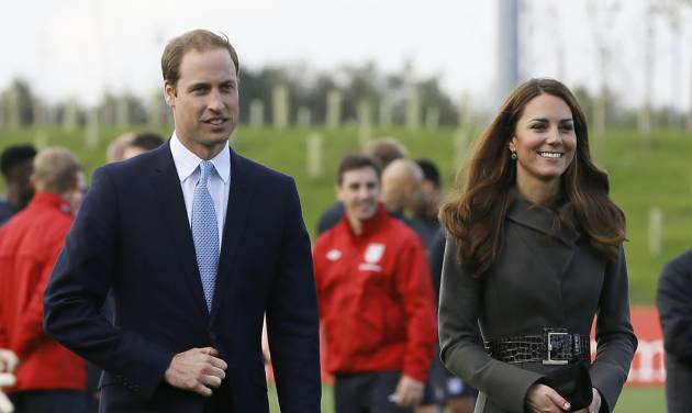 Britain's Prince William , left and Kate, Duchess of Cambridge, walk as they view a football training pitch at St George's Park near Burton Upon Trent in Staffordshire, England, Tuesday, Oct. 9, 2012. Britain's Duke and Duchess of Cambridge visited the new national training facility for England's football teams, to officially open the 330 acre site which includes indoor and outdoor training pitches, a hotel, conference centre, medical facilities, health club and spa. (AP Photo/Kirsty Wigglesworth)
