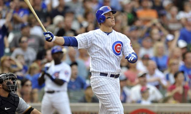 Chicago Cubs' Anthony Rizzo watches his grand slam home run in the sixth inning during a baseball game against the Pittsburgh Pirates in Chicago, Sunday, Sept. 16, 2012. (AP Photo/Paul Beaty)