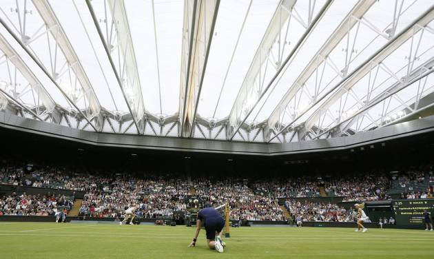 The roof is closed on Centre Court as Agnieszka Radwanska of Poland, right, plays Mathilde Johansson of France during their Women's second round singles match at the All England Lawn Tennis Championships in Wimbledon, London, Thursday, June 27, 2013. (AP Photo/Kirsty Wigglesworth)