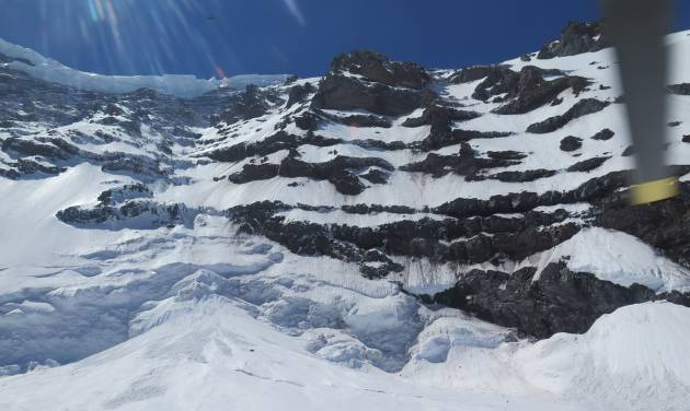 This photo provided by the National Parks Service, shows the Liberty Ridge Area of Mount Rainier as viewed from the Carbon Glacier, Saturday, May 31, 2014, in Washington state. Six climbers missing on Mount Rainier are presumed dead after helicopters detected pings from emergency beacons buried in the snow thousands of feet below their last known location, a national park official said Saturday. (AP Photo/National Park Service)