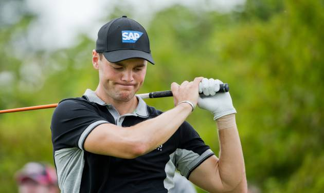 Germany's  Martin Kaymer  looks on during  the  BMW International Open golf tournament  in Pulheim near Cologne, Germany,  Friday June 27, 2014.  (AP Photo/dpa,Rolf Vennenbernd)