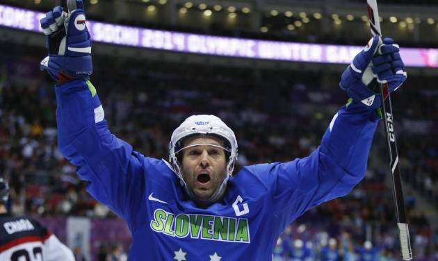 Slovenia forward Tomaz Razingar reacts after scoring a goal against Slovakia in the third period of a men's ice hockey game at the 2014 Winter Olympics, Saturday, Feb. 15, 2014, in Sochi, Russia. (AP Photo/Julio Cortez)