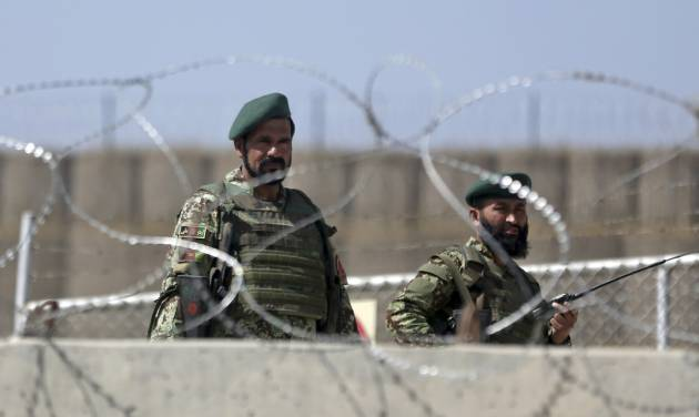Afghanistan National Army soldiers stand guard at a gate of Camp Qargha, west of  Kabul, Afghanistan, Tuesday, Aug. 5, 2014. Earlier in the day, a man dressed in an Afghan army uniform opened fire on foreign troops at the military base, killing a U.S. two-star general and wounding others, among them a German brigadier general and a number of Americans troops, authorities said. (AP Photo/Massoud Hossaini)