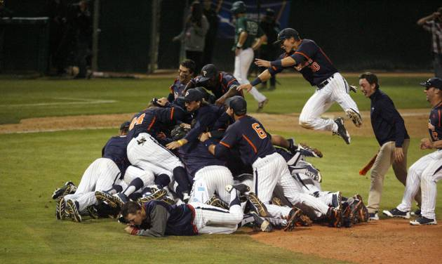 Pepperdine players celebrates on the mound after the final out against Cal Poly in an NCAA college baseball tournament regional game on Sunday, June 1, 2014, in San Luis Obispo, Calif. (AP Photo/Aaron Lambert)