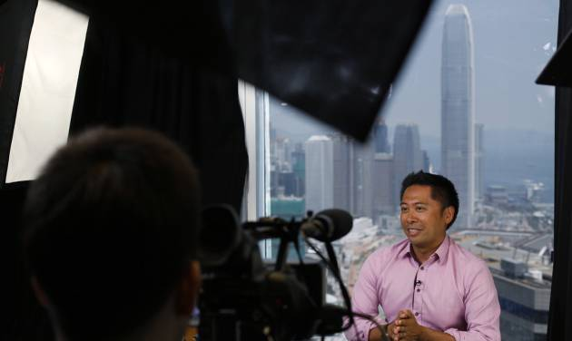 Jeff Floro, a hobbyist director, speaks during an interview in Hong Kong Friday, July 12, 2013. It was shot in single takes with amateur actors, hobbyist directors and about $650 - mainly to book a room in the same Hong Kong hotel that briefly housed National Security Agency leaker Edward Snowden. Floro said he and the other directors, Edwin Lee, Shawn Tse and Marcus Tsui, had only wanted to hone their guerrilla filmmaking style and produce something that was relevant to Hong Kong at that time. (AP Photo/Kin Cheung)