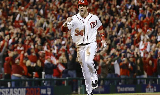 Washington Nationals' Bryce Harper heads home on a home run by Ryan Zimmerman during the first inning of Game 5 of the National League division baseball series against the St. Louis Cardinals on Friday, Oct. 12, 2012, in Washington. (AP Photo/Alex Brandon)