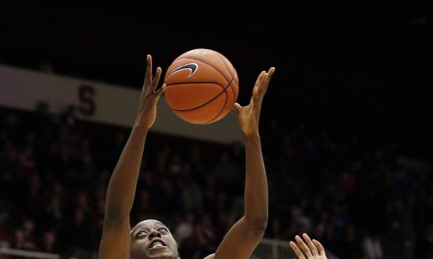Stanford 's Chiney Ogwumike (13) grabs a lob pass in front of UCLA 's Atonye Nyingifa (11) during the first half of an NCAA college basketball game Friday, Jan. 24, 2014, in Stanford, Calif. (AP Photo/Marcio Jose Sanchez)