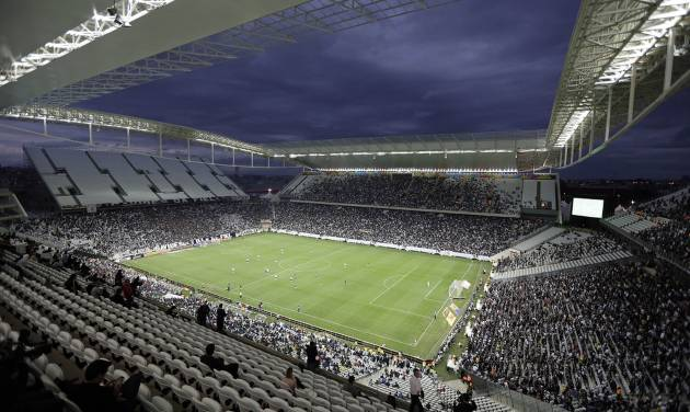 Corinthians's and Botafogo players battle it out during a Brazilian soccer league match at the Itaquerao, the stadium that will host the World Cup opener match between Brazil and Croatia on June 12, in Sao Paulo, Brazil, Sunday, June 1, 2014. (AP Photo/Andre Penner)