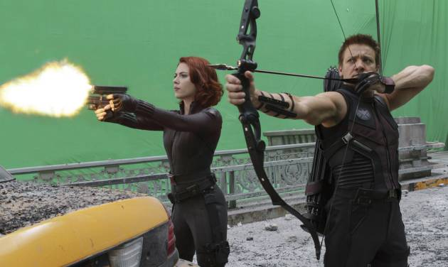 "In this film image released by Disney, Scarlett Johansson portraying Black Widow, left, and Jeremy Renner, portraying Hawkeye, are shown during the filming of Marvel's ""The Avengers."" (AP Photo/Disney, Zade Rosenthal)"