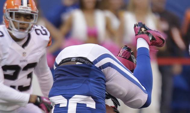 Indianapolis Colts' Vick Ballard (33) is upended by Cleveland Browns' Craig Robertson (53) during the second half of an NFL football game Sunday, Oct. 21, 2012, in Indianapolis. (AP Photo/Michael Conroy)