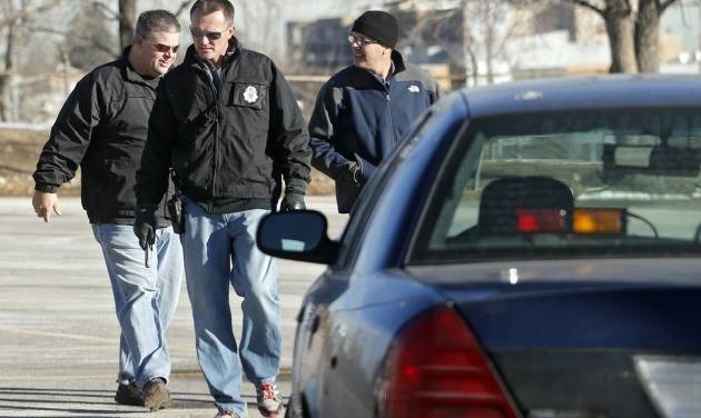 Denver Police detectives investigate the scene of a stabbing on Friday, Dec. 13, 2013, in a parking lot adjacent to Sports Authority Stadium where three people were stabbed during a fight after an NFL football game between San Diego and Denver on Thursday. (AP Photo/Ed Andrieski)