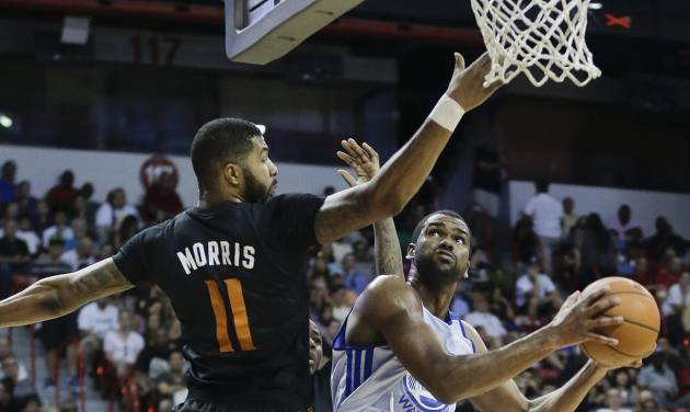 Golden State Warriors' James Southerland, right, goes up for a shot against Phoenix Suns' Markieff Morris in the second quarter of the NBA Summer League championship game, Monday, July 22, 2013, in Las Vegas. (AP Photo/Julie Jacobson)
