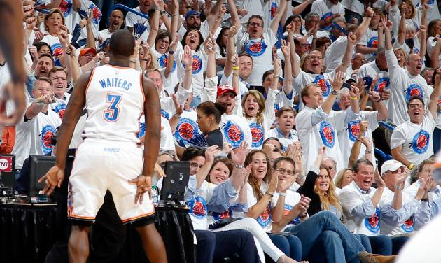 Oklahoma City\'s Dion Waiters celebrates after a basket during Game 4 of the Western Conference...