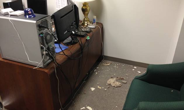 Pieces of concrete sit on the floor in an office at the state Capitol on Monday. The pieces apparently fell through a ceiling tile into the basement office over the weekend. PHOTO PROVIDED