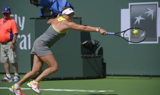 Vera Zvonareva, of Russia, returns a shot against Peng Shuai, of China, during a first round match at the BNP Paribas Open tennis tournament, Wednesday, March 5, 2014, in Indian Wells, Calif. (AP Photo/Mark J. Terrill)