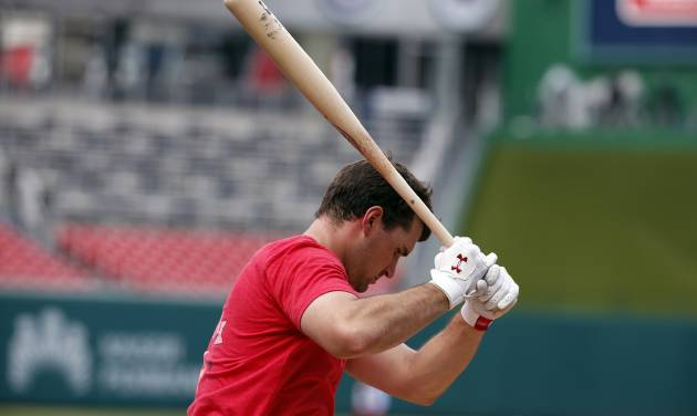 Washington Nationals third baseman Ryan Zimmerman holds the bat during batting practice before a baseball game against the Miami Marlins at Nationals Park on Wednesday, May 28, 2014, in Washington. Zimmerman is on the disabled list with a broken thumb, and was recently cleared to swing a bat. (AP Photo/Alex Brandon)
