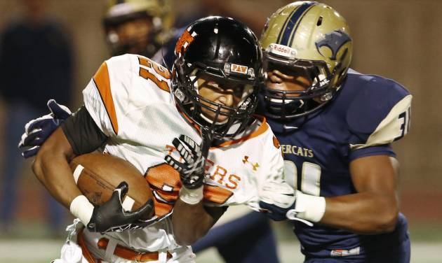 Norman's Imond Robinson is tackled by Southmoore's Terrance Bonner during the first half in Moore, Friday  October 12, 2012. Photo By Steve Gooch, The Oklahoman