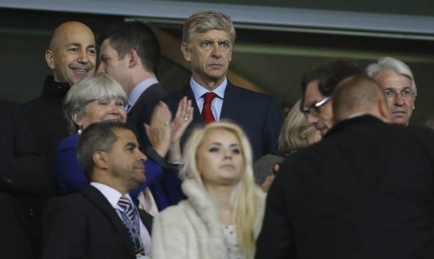 Arsenal's manager Arsene Wenger, centre, watches from the stands as his team prepares to play FC Schalke 04 in their Champions League group B soccer match between Arsenal and FC Schalke 04 at the Emirates Stadium in London, Wednesday, Oct. 24, 2012. (AP Photo/Kirsty Wigglesworth)