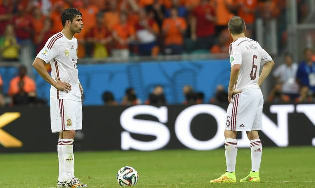 Spain's Diego Costa, left, and Spain's Andres Iniesta react after Netherlands' Arjen Robben scored during the group B World Cup soccer match between Spain and the Netherlands at the Arena Ponte Nova in Salvador, Brazil, Friday, June 13, 2014. (AP Photo/Manu Fernandez)