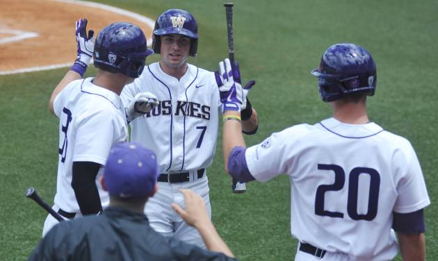 Washington's Braden Bishop (7) is congratulated by teammates Branden Berry (36) and Trevor Mitsui (20) after scoring against Georgia Tech at the NCAA Oxford Regional at Oxford-University Stadium on Saturday, May 31, 2014. (AP Photo/Oxford Eagle, Bruce Newman)