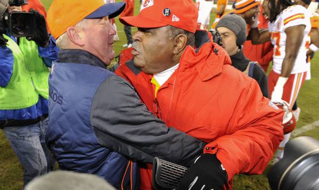 Denver Broncos head coach John Fox, left, greets Kansas City Chiefs coach Romeo Crennel at the end of an NFL football game, Sunday, Dec. 30, 2012, in Denver. Denver won 38-3. (AP Photo/Jack Dempsey)