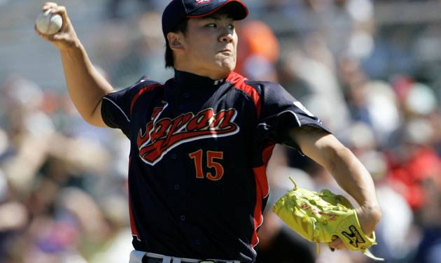 FILE - In this March 11, 2009, file photo, Japan's Masahiro Tanaka pitches to the San Francisco Giants during an exhibition baseball game in Scottsdale, Ariz. The New York Yankees and Tanaka agreed on Wednesday, Jan. 22, 2014, to a $155 million, seven-year contract. In addition to the deal with the pitcher, the Yankees must pay a $20 million fee to the Japanese team of the 25-year-old right-hander, the Rakuten Golden Eagles. (AP Photo/Jeff Chiu, File)